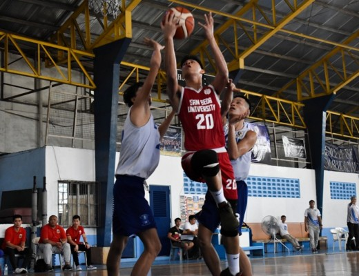 Justine Sanchez of San Beda goes up for a layup against Arellano Brave defenders (Fr. Martin's Cup photo)
