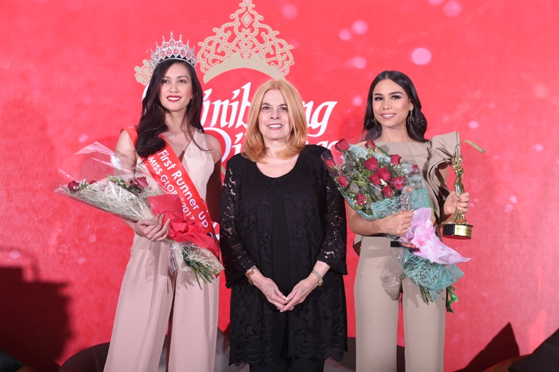 Nelda Ibe, Miss Globe 2017 first runner up, and Elizabeth Clenci, Miss Grand International second runner up, are congratulated by Binibining Pilipinas Charities Inc. Chairwoman Madam Stella Marquez Araneta.