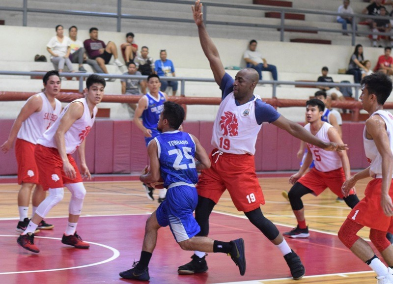 Red Lions big man Donaldo Tankoua is seen screening an opposing player