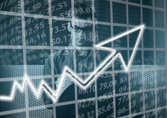 Tokyo stocks open lower on strong yen