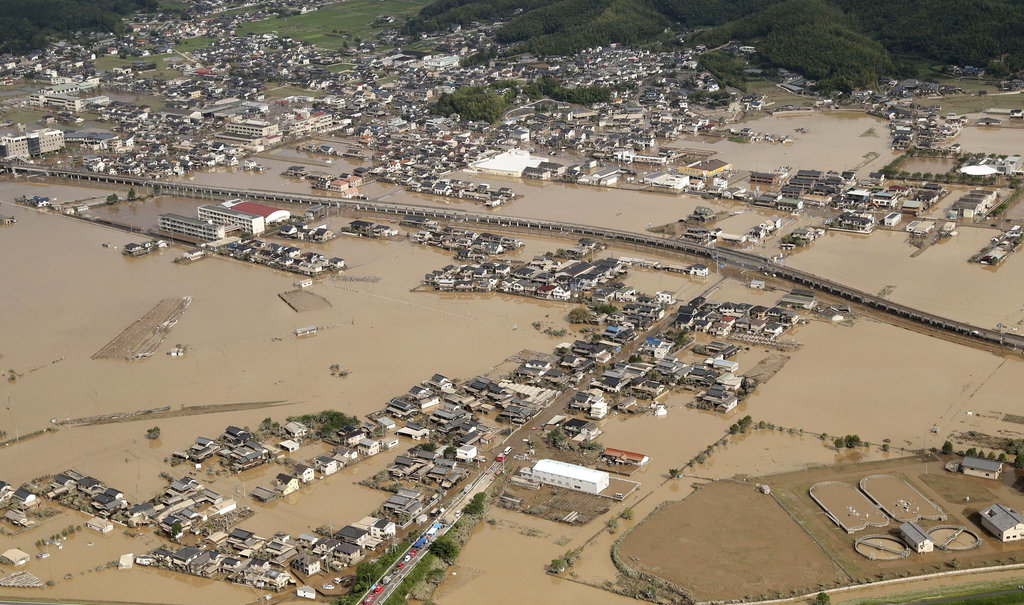 Rescuers search for dozens still missing after Japan floods