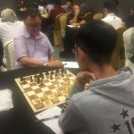8-time World Chess Olympiad member International Master (IM) Rico Yap Mascarinas from Cebu (left) picked up his third win in the tournament as Board 2 player after beating Qing Yang Ng in their Sicilian defense duel.