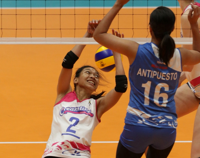 Angel Antipuesto of Pocari foils one of Creamline's Alyssa Valdez's vaunted attacks in sudden death of their semis duel.