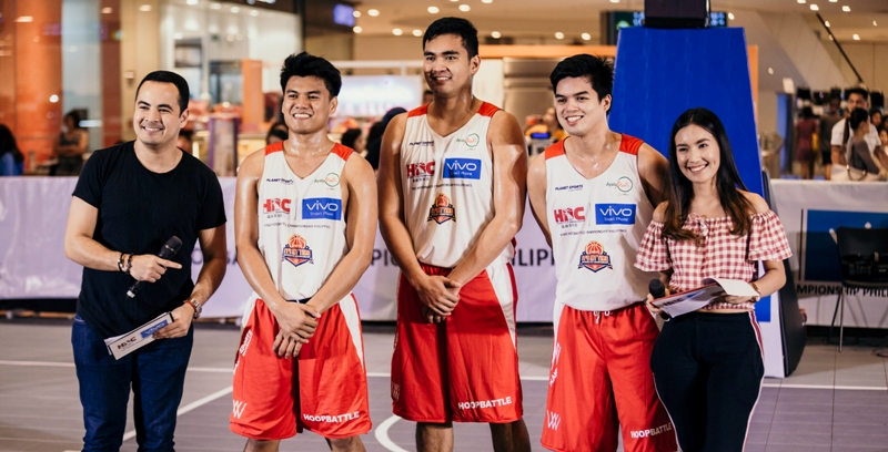 Members of Team Enderun pose after placing second in the final elims leg of the VIVO Hoop Battle Championship Philippines at Fairview Terraces. With them are event hosts Andrei Felix and Sydney Crespo.