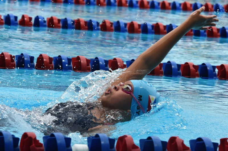 Mishka Sy  shows winning form on the way to victory in the girls 13-under 200-meter backstroke in the 42nd SEA Age Group Swimming Championships at the Trace Aquatics Center in Los Banos Laguna.