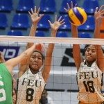 St. Benilde's Arianne Daguil (16) defies FEU's defense put up by Angelica Cayuna (8) and Virginia Villareal as she bangs in a power hit during their PVL Collegiate Conference clash at the Filoil Flying V Center.