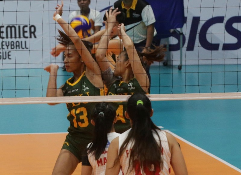 FEU's Celine Domingo and Heather Anne Guino-o struggle trying to keep the ball in play as San Beda's Aurea Racraquin (18) and Lynne Matias (partly hidden) look on.