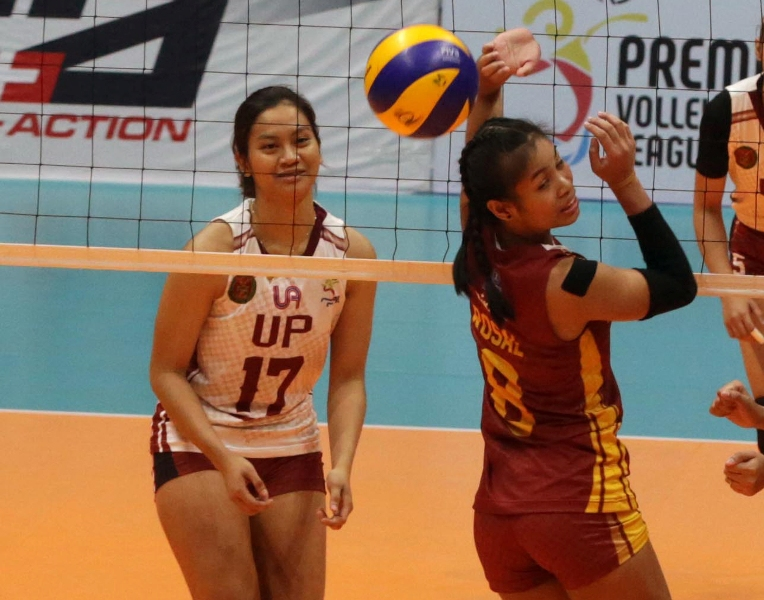 UP's Ayel Estranero reacts as the ball sails over the head of Perpetual Help's Jhona Rosal for another point for the Fighting Maroons during their PVL Collegiate Conference clash at the Filoil Center.