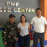 Lieutenant Colonel Vicente Flora Jr. (right) of Philippine Airforce chess team and Senior Sargeant National Master Ronald Llavanes, coach of Philippine Airforce chess team (left) take a sovenir photo with country's Woman Grandmaster Janelle Mae Frayna (center)