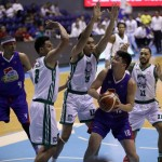 Ian Sangalang of Magnolia defended by Jeepy Faundo and Russel Escoto of Columbian (PBA Images)
