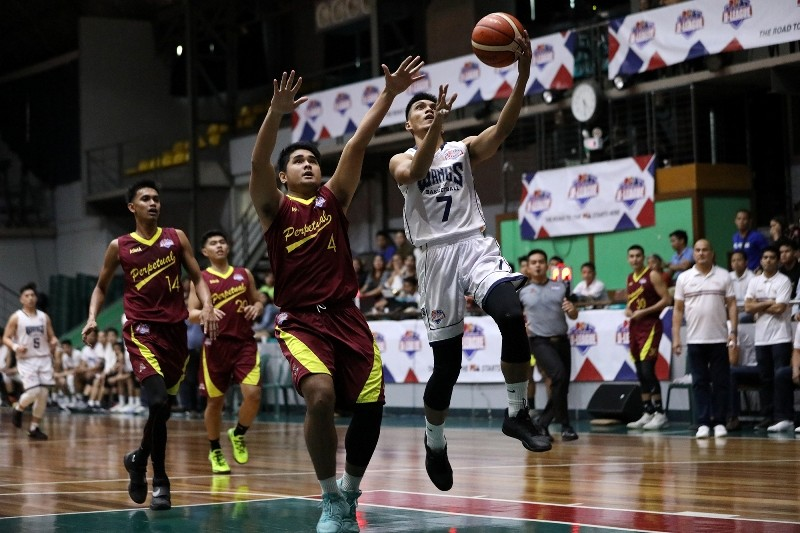 Rickson Gerero of Wangs gets away from Jerome Pasia of Perpetual (PBA Images)