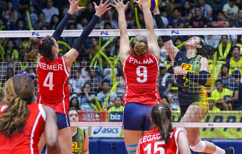 Blaze Spikers defend Aby Marano of F2 Logistics (PSL images)