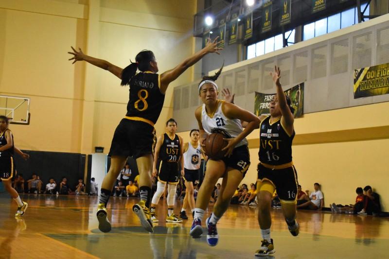 Camille Clarin (NU 21) vs UST's Eka Soriano (8) and Taki Tacatac (16)