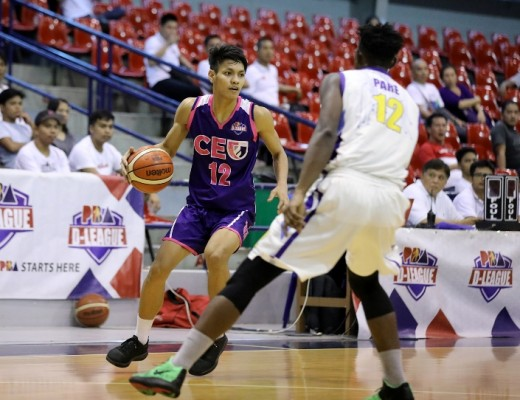 Jerome Santos of CEU guarded by Mohammad Pare of St. Clare College (PBA Images)