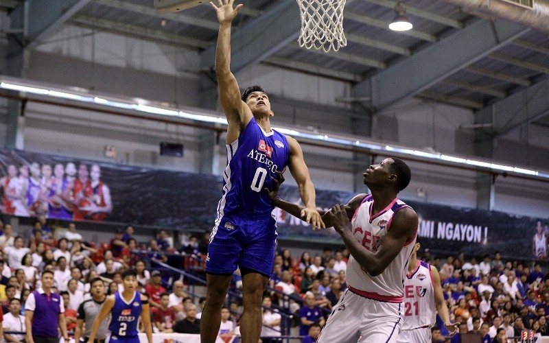 Thirdy Ravena of Ateneo goes up for a shot as Malick Diouf of CEU looks on. (PBA Images)