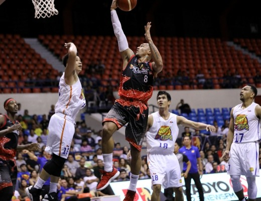 Calvin Abueva of Phoenix Pulse lays it up against RR Pogoy of TnT KaTropa (PBA Images)