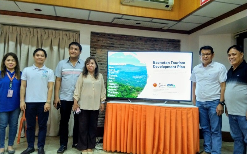 From left, Municipal Planning and Development Officer Francia Gonzales, Consultant Aaron Lecciones of the Society for the Conservation of Philippine Wetlands, Bacnotan Mayor Francisco Angelito Fontanilla, Vice Mayor Divine Fontanilla, Holcim Bacnotan Plant Manager Erano Santos and Sangguniang Bayan Member Frank Almodovar after the turnover of the masterplan