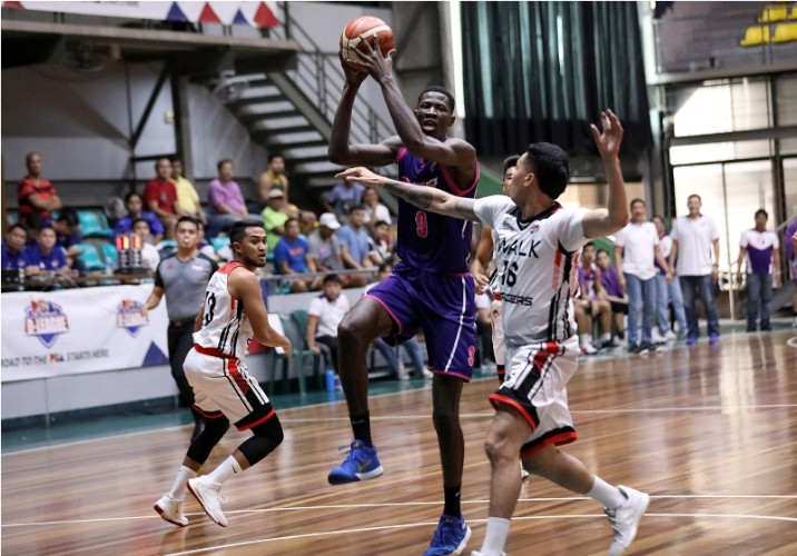 Malick Diouf of CEU is challenged by  Jaypee Belencion of iWalk. (PBA Images)