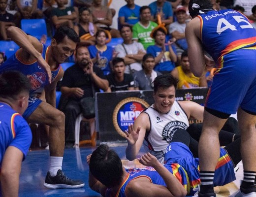 Players of SOCCSKSARGEN and Caloocan enjoy the moment after battling for the loose ball