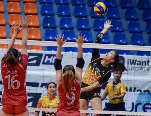 UST's Janna Torres soars for a tip against Lyceum's Zonki Dahab