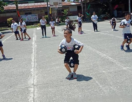 FOOTBALL RACE. These kids have fun playing the football race during the Sports for Peace Children's Games held at Holy Cross of Malita, Davao Occidental on September 7. PSC MINDANAO