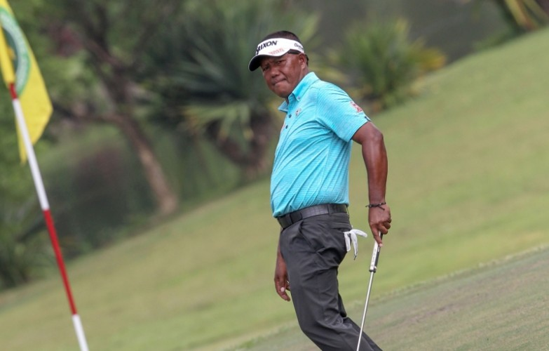 Tony Lascuna does a body language as he watches his birdie putt drop on No. 12