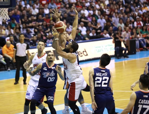 Stanley Pringle of Barangay Ginebra goes up for a shot against John Pinto of the Meralco Bolts in the PBA PH Cup Finals. The Kings won to take a 2-1 series lead. (PBA Images)