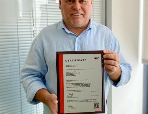 Eugene Kaspersky holding ISO 27001 certificate