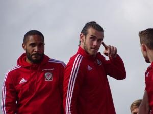 Gareth Bale with Ashley Williams (left) [photo credit: Jon Candy | Wikimedia Commons]