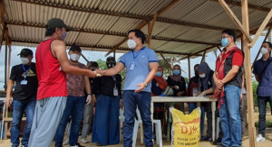 Displaced families sheltered in Sagonsongan Transitory Shelter Site receive one sack (25 kilos) of rice and P1, 500 cash assistance from the Task Force Bangon Marawi. The distribution of the relief assistance was led by TFBM Field Office Manager Asec. Felix Castro Jr. and Marawi City Mayor Majul Gandamra. (PIA ICIC)