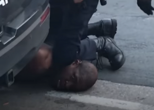 Youtube screenshot of George Floyd being arrested [@NowThisNews]