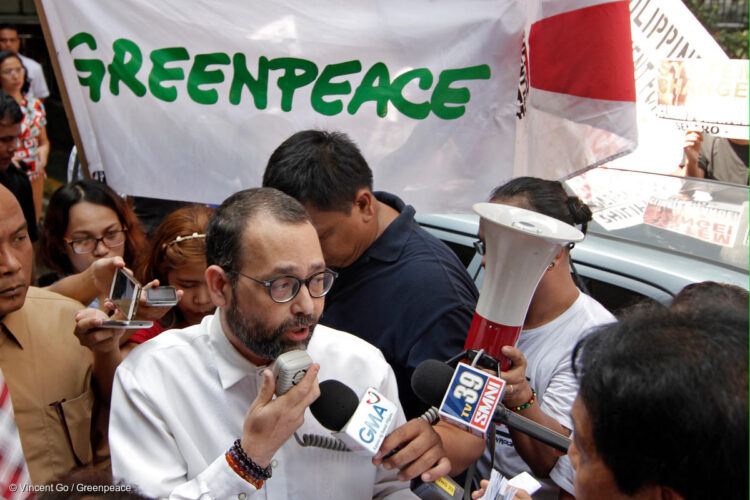 Commissioner Jose Luis Martin Gascon welcomes environmental petitioners to the Commission on Human Rights main office during the filing of the world's first Climate Change and Human Rights Inquiry. (September 22, 2015- Photo by Vincent Go/Greenpeace)